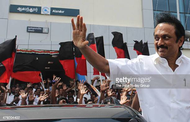 DMK tresurer M K Stalin greets the party men while leaving after completing a ride in the newly inaugurated Chennai metro train