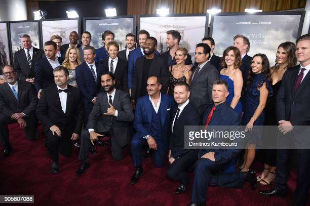 Trevante Rhodes Michael Shannon Chris Hemsworth Michael Pena and Allison King pose with the cast and crew at the world premiere of '12 Strong' at...
