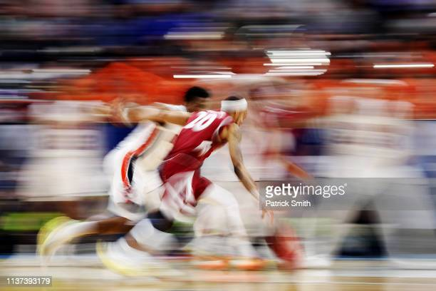 Trevelin Queen of the New Mexico State Aggies dribbles the ball during the first half against the Auburn Tigers in the first round of the 2019 NCAA...