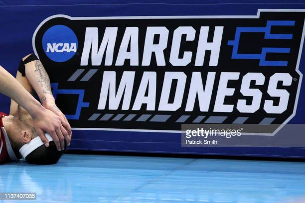 Trevelin Queen of the New Mexico State Aggies reacts after being defeated by the Auburn Tigers 7877 in the first round of the 2019 NCAA Men's...