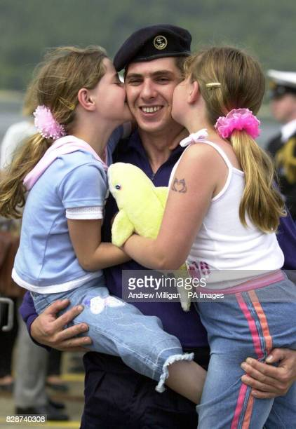 Trevellan Stevenson is greeted by his eightyearold twins Natasha and Alix as HMS Splendid returns from the Gulf to HM Naval base Clyde Faslane * The...