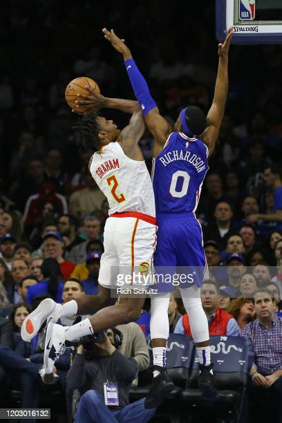 Treveon Graham of the Atlanta Hawks attempts a shot as Josh Richardson of the Philadelphia 76ers defends during the first half of an NBA basketball...