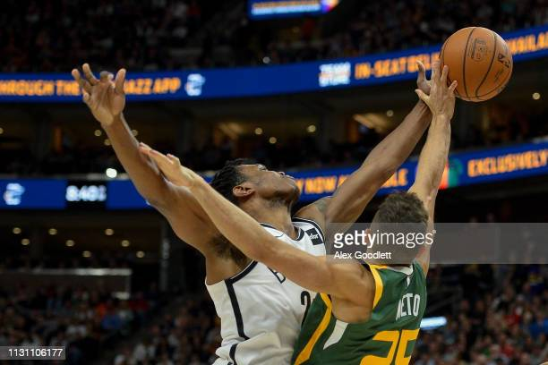 Treveon Graham of the Brooklyn Nets fights for the ball with Raul Neto of the Utah Jazz during a game at Vivint Smart Home Arena on March 16 2019 in...
