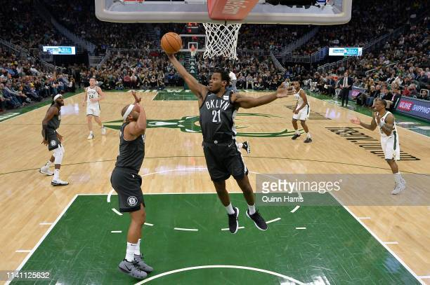 Treveon Graham of the Brooklyn Nets grabs a rebound in the second half against the Milwaukee Bucks at Fiserv Forum on April 06 2019 in Milwaukee...