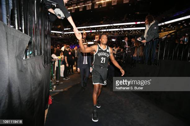 Treveon Graham of the Brooklyn Nets hifives fans after the game against the Chicago Bulls on January 29 2019 at Barclays Center in Brooklyn New York...