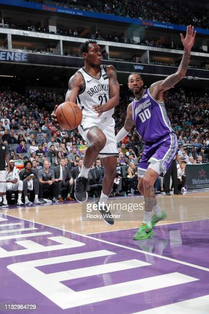Treveon Graham of the Brooklyn Nets passes against Willie CauleyStein of the Sacramento Kings on March 19 2019 at Golden 1 Center in Sacramento...