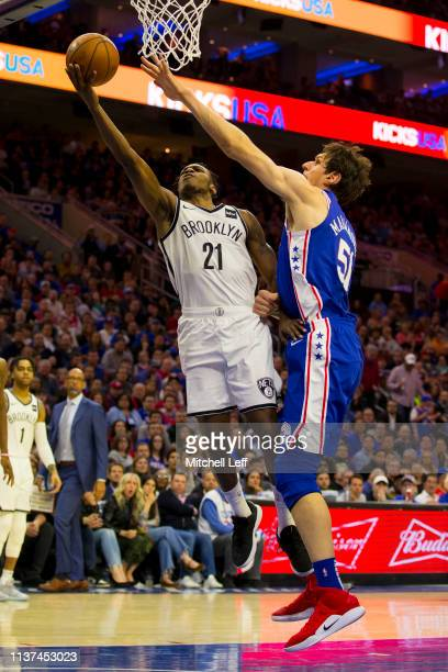 Treveon Graham of the Brooklyn Nets shoots the ball Boban Marjanovic of the Philadelphia 76ers in the second quarter of Game Two of Round One of the...