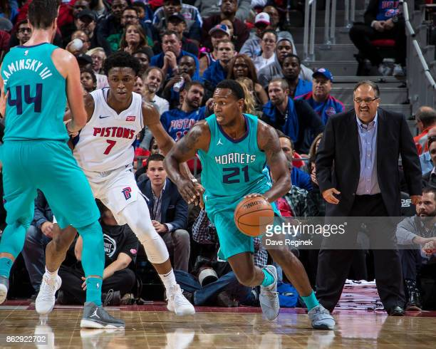Treveon Graham of the Charlotte Hornets drives the basket next to Stanley Johnson of the Detroit Pistons during the Inaugural NBA game at the new...