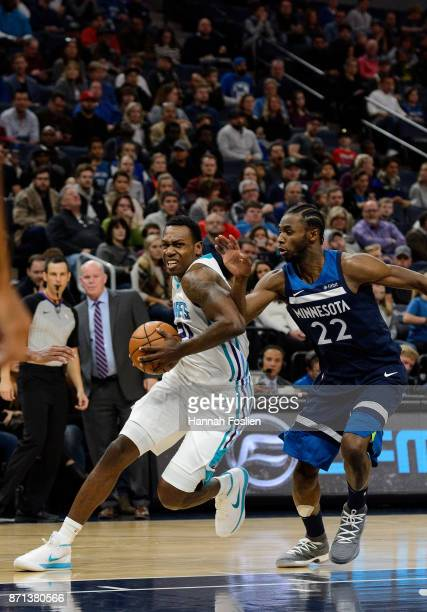 Treveon Graham of the Charlotte Hornets drives to the basket against Andrew Wiggins of the Minnesota Timberwolves during the game on November 5 2017...