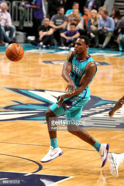 Treveon Graham of the Charlotte Hornets passes the ball against the Milwaukee Bucks on November 1 2017 at Spectrum Center in Charlotte North Carolina...
