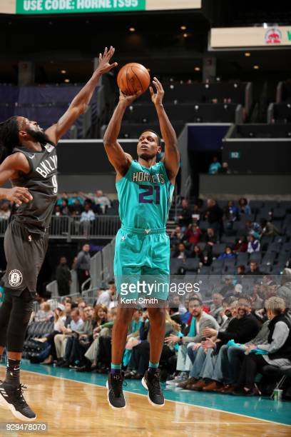 Treveon Graham of the Charlotte Hornets shoots the ball against the Brooklyn Nets on March 8 2018 at Spectrum Center in Charlotte North Carolina NOTE...