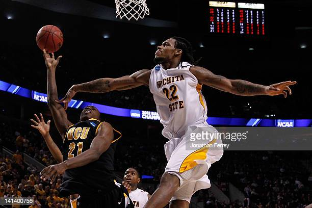 Treveon Graham of the Virginia Commonwealth Rams goes up for a shot against Carl Hall of the Wichita State Shockers in the second round of the 2012...