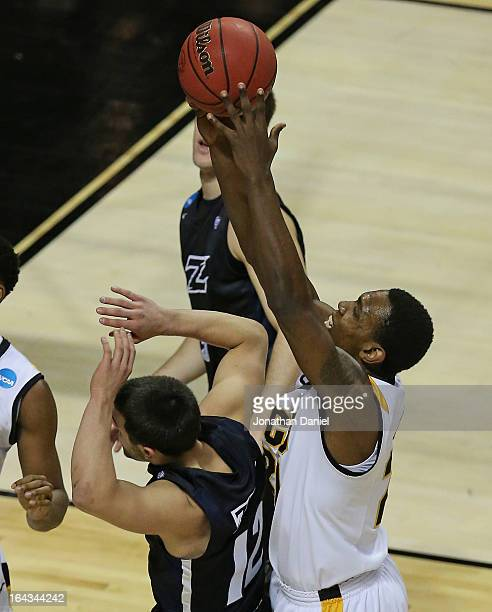 Treveon Graham rebounds over Carmelo Betancourt of the VCU Rams of the Akron Zips during the second round of the 2013 NCAA Men's Basketball...