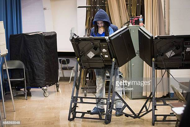Treveyon Brock casts his ballot at polling place on November 4 2014 near Ferguson Missouri In last Aprils election only 1484 of Ferguson's 12096...
