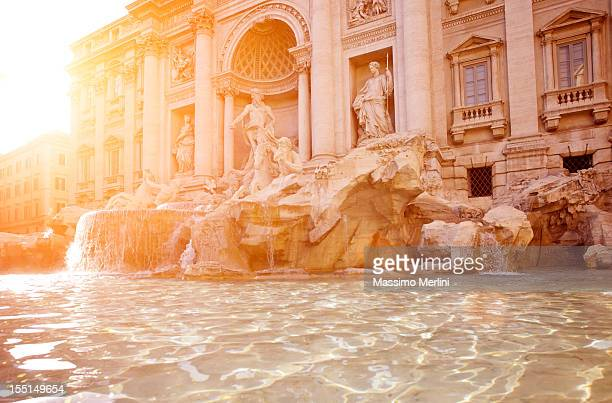 trevi fountain at sunset - trevi fountain stock photos and pictures