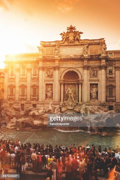 trevi fountain in rome full of tourist at dusk - trevi fountain stock photos and pictures