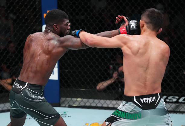 Trevin Jones of Guam punches Saidyokub Kakhramonov of Uzbekistan in a bantamweight fight during the UFC Fight Night event at UFC APEX on August 21,...