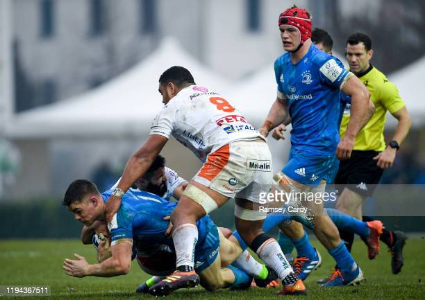 Treviso Italy 18 January 2020 Garry Ringrose of Leinster is tackled by Tito Tebaldi left and Toa Halafihi of Benetton during the Heineken Champions...