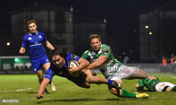 Treviso Italy 2 December 2017 James Lowe of Leinster dives over to score his side's fifth try despite the tackle of Tommaso Benvenuti of Benetton...