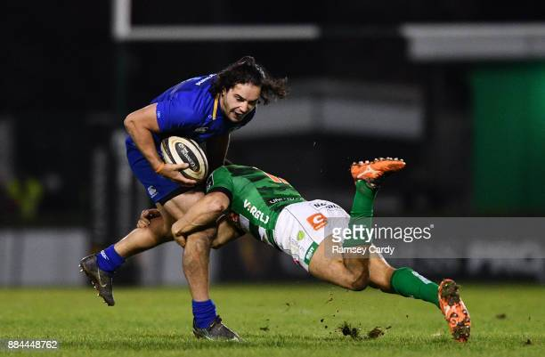 Treviso Italy 2 December 2017 James Lowe of Leinster is tackled by Ignacio Brex of Benetton during the Guinness PRO14 Round 10 match between Benetton...