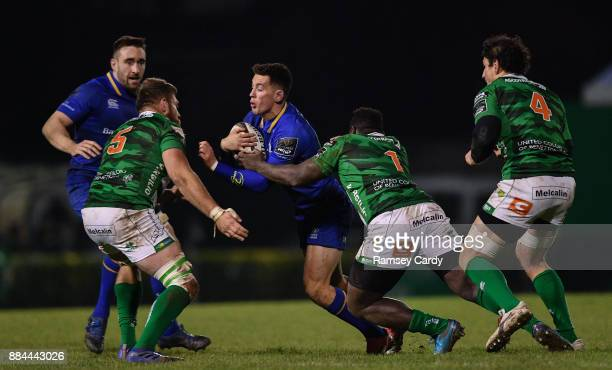 Treviso Italy 2 December 2017 Noel Reid of Leinster is tackled by Irné Herbst left and Cherif Traore of Benetton during the Guinness PRO14 Round 10...