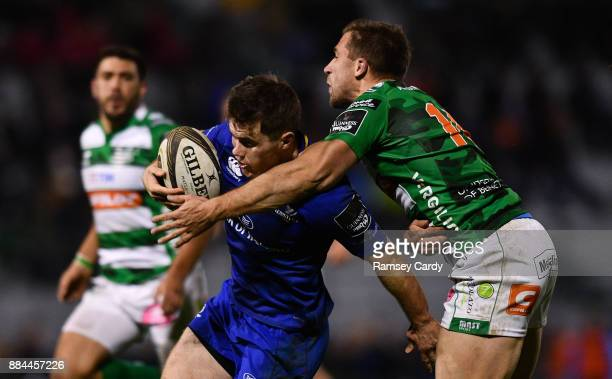Treviso Italy 2 December 2017Luke McGrath of Leinster on his way to scoring his side's fourth try despite the tackle of Tommaso Benvenuti of Benetton...