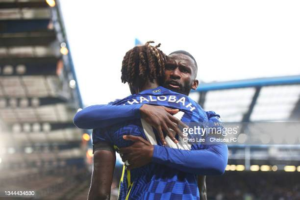 Trevoh Chalobah of Chelsea celebrates with teammate Antonio Ruediger after scoring their side's first goal during the Premier League match between...