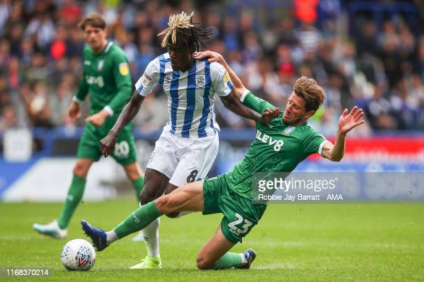 Trevoh Chalobah of Huddersfield Town and Sam Hutchinson of Sheffield Wednesday during the Sky Bet Championship match between Huddersfield Town and...