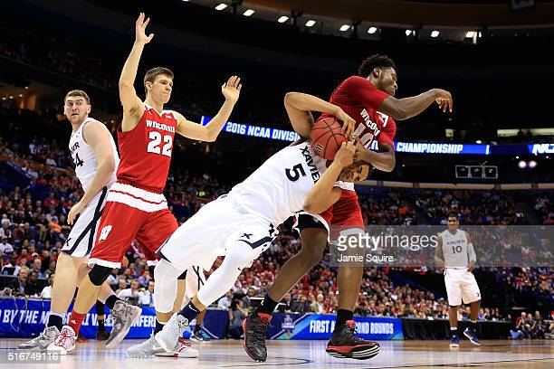 Trevon Bluiett of the Xavier Musketeers and Nigel Hayes of the Wisconsin Badgers get tangled up going for the ball in the second half during the...