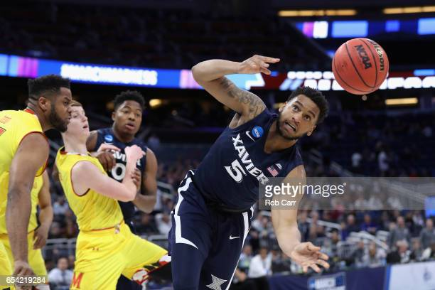 Trevon Bluiett of the Xavier Musketeers attempts to handle the ball in the first half against the Maryland Terrapins during the first round of the...