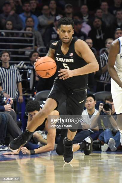 Trevon Bluiett of the Xavier Musketeers dribbles up court during a college basketball game against the Villanova Wildcats at Wells Fargo Arena on...