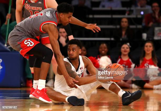 Trevon Bluiett of the Xavier Musketeers looks to pass against Justin Simon of the St John's Red Storm in th first half in the Big East basketball...