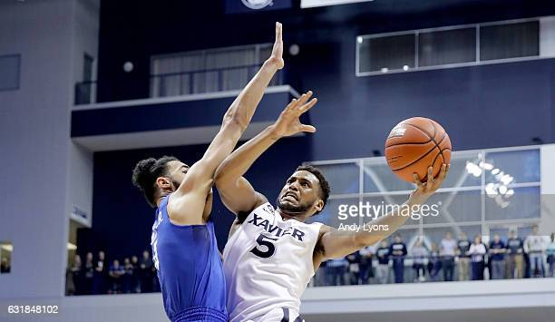 Trevon Bluiett of the Xavier Musketeers shoots the ball against the Creighton Blue Jays during the game at Cintas Center on January 16 2017 in...