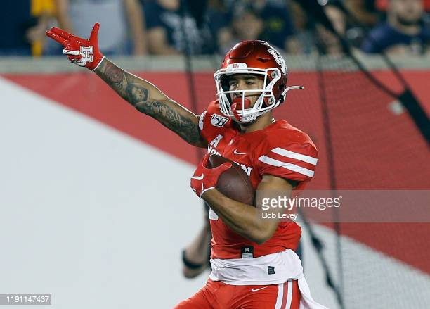Tre'von Bradley of the Houston Cougars runs for a 67yard touchdown after a reception against the Navy Midshipmen during the first quarter on November...