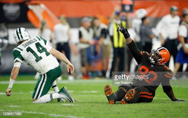 Trevon Coley of the Cleveland Browns celebrates in front of Sam Darnold of the New York Jets after an interception by Terrance Mitchell during the...