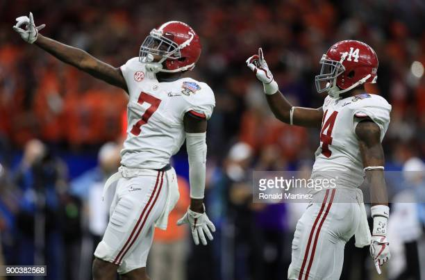 Trevon Diggs of the Alabama Crimson Tide and Deionte Thompson react in the second half fo the AllState Sugar Bowl against the Clemson Tigers at the...