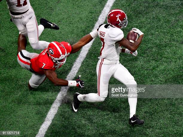 Trevon Diggs of the Alabama Crimson Tide breaks the tackle of Lorenzo Carter of the Georgia Bulldogs in the CFP National Championship presented by...