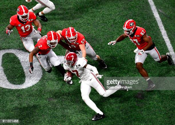 Trevon Diggs of the Alabama Crimson Tide carries the ball against Richard Lecounte Trent Frix Jonathan Ledbetter and Miles McGinty of the Georgia...