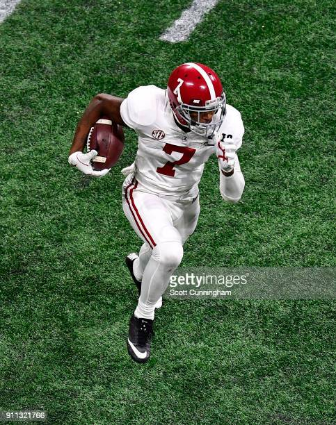 Trevon Diggs of the Alabama Crimson Tide carries the ball against the Georgia Bulldogs in the CFP National Championship presented by ATT at...