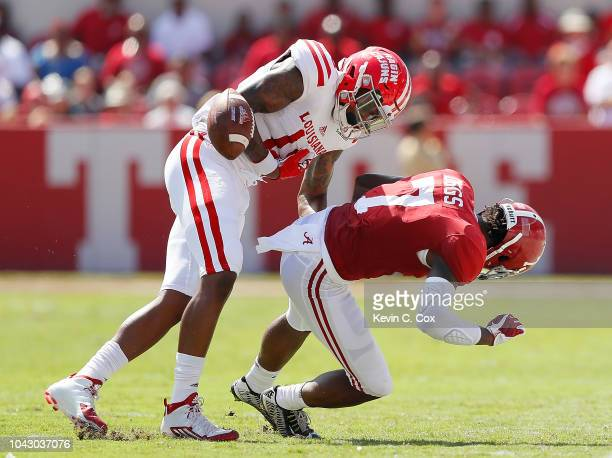 Trevon Diggs of the Alabama Crimson Tide forces a fumble by Jalen Williams of the Louisiana Ragin Cajuns at Bryant-Denny Stadium on September 29,...