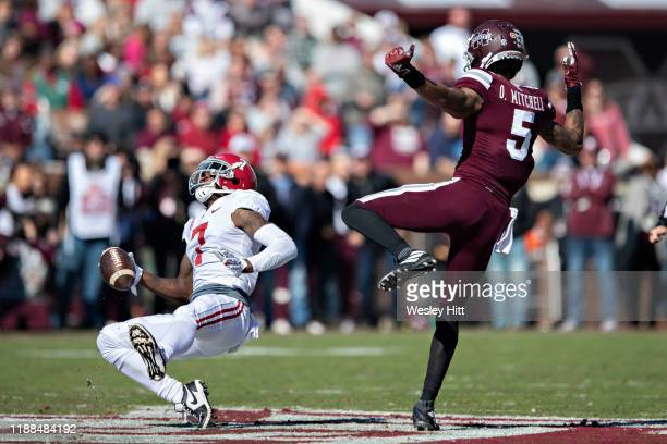 Trevon Diggs of the Alabama Crimson Tide intercepts a pass thrown to Osirus Mitchell of the Mississippi State Bulldogs at Davis Wade Stadium on...