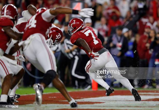 Trevon Diggs of the Alabama Crimson Tide returns a fumble in the end zone for a touchdown against the Tennessee Volunteers in the second half at...