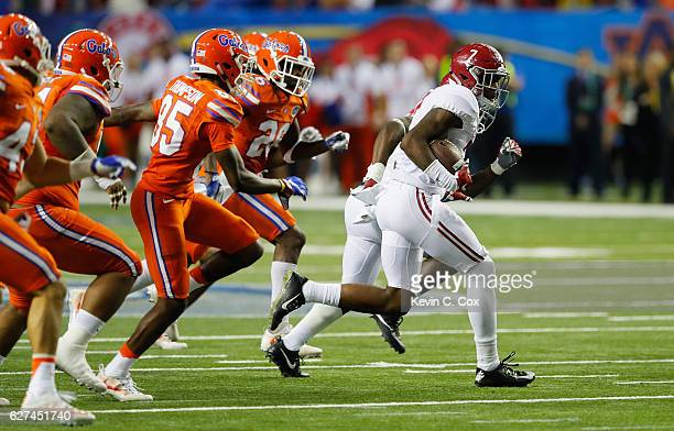 Trevon Diggs of the Alabama Crimson Tide returns a punt in the second half against the Florida Gators during the SEC Championship game at the Georgia...