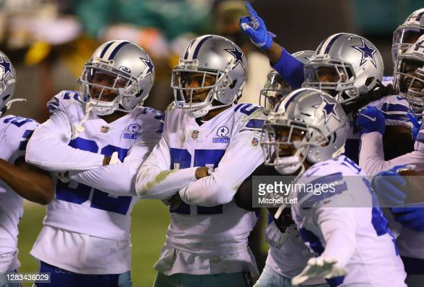 Trevon Diggs of the Dallas Cowboys and teammates celebrate an interception against the Philadelphia Eagles in the third quarter at Lincoln Financial...
