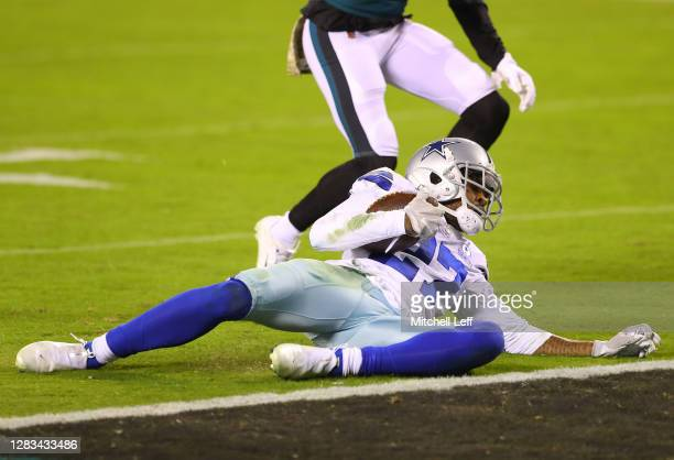 Trevon Diggs of the Dallas Cowboys holds onto the ball for the interception against the Philadelphia Eagles in the third quarter of the game at...