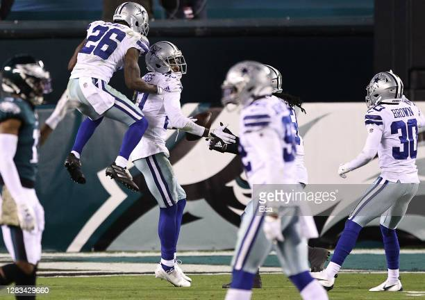 Trevon Diggs of the Dallas Cowboys is congratulated by teammates after intercepting a Carson Wentz of the Philadelphia Eagles pass to the end zone...
