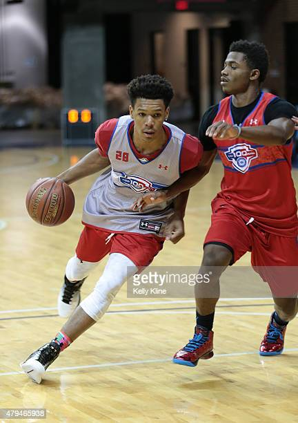 Trevon Duval in white drives to the hoop during the NBPA Top 100 Camp on June 19 2015 at John Paul Jones Arena in Charlottesville Virginia