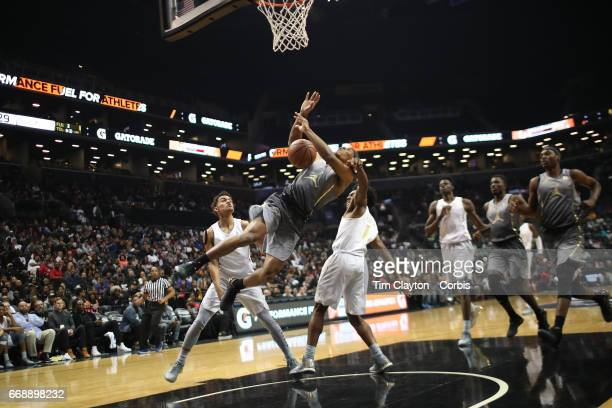 Trevon Duval of IMG Academy Brandenton Florida playing for the East team is fouled by Collin Sexton of Pebblebrook HS Mableton Georgia playing for...