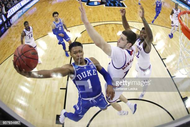 Trevon Duval of the Duke Blue Devils attempts a lay up against Sviatoslav Mykhailiuk and Silvio De Sousa of the Kansas Jayhawks in the 2018 NCAA...