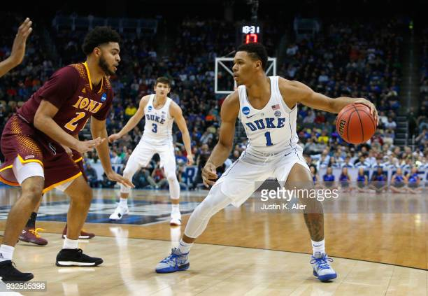 Trevon Duval of the Duke Blue Devils controls the ball against EJ Crawford of the Iona Gaels during the first half of the game in the first round of...